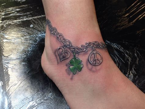 charm tattoo ankle bracelet with peace sign clover