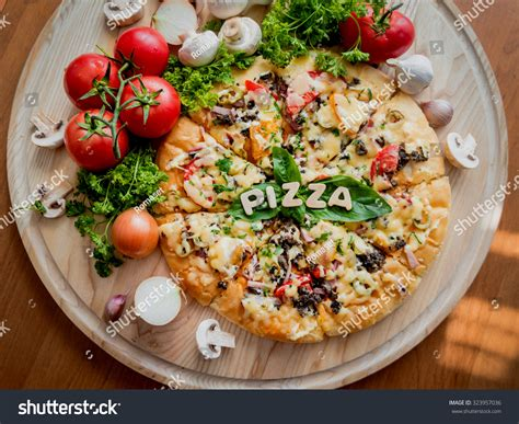 large pizza table large pizza on wooden table restaurant stock photo