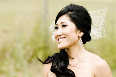 side ponytail wedding hairstyles with veil asian wears side ponytail net veil bow