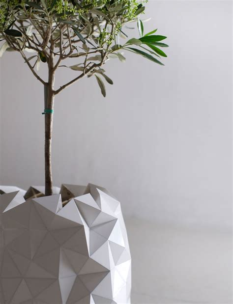 Plant Origami - shape shifting origami pots that grow together with your
