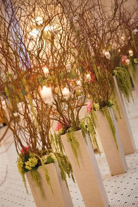 wedding aisle branches curly willow trees wedding the church