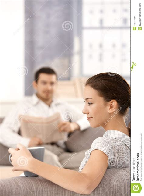 young couple room young couple sitting in living room at home stock images