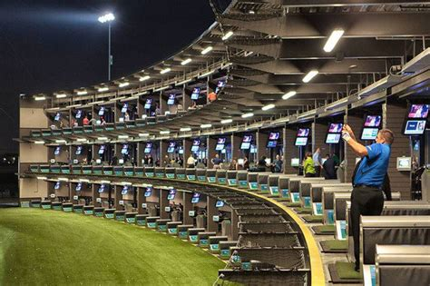 lighted driving range near me inside look at topgolf s high tech driving ranges cio