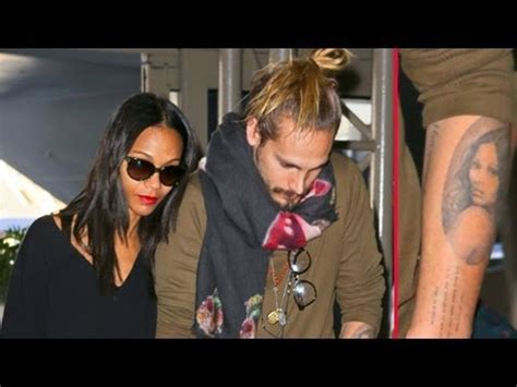 zoe saldana and hubby marco perego show pda at lax youtube