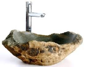 Natural stone sinks complementing fresh bathroom interiors