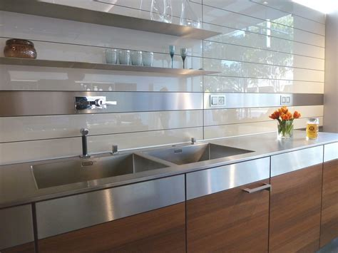 glass wall kitchen kitchen rear wall has a backlit glass niche with
