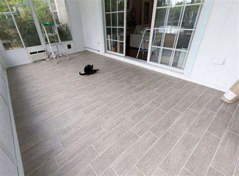 reader redesign endless summer grey wood tile woods and sunroom