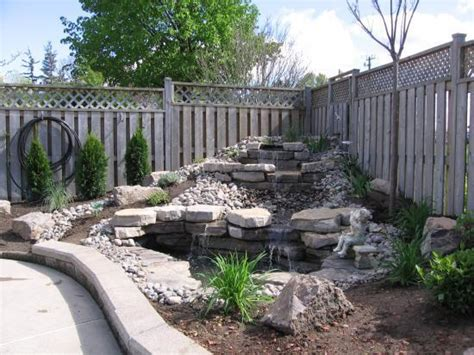 waterfalls for backyards backyard waterfall doityourself
