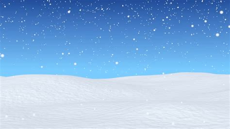 christmas snow falls gently on rolling snow covered hills