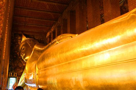 Reclining Budda by Wat Pho And It S Reclining Buddha In Bangkok Thailand