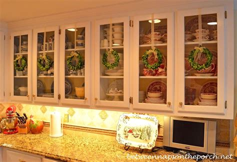 Decorating Ideas For Glass Kitchen Cabinets Decorate Kitchen Cabinets With Preserved Boxwood Wreaths