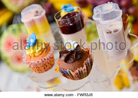 rainbow cake and cupcakes decorated with birthday candles rainbow cake and cupcakes decorated with birthday candles balloons stock photo royalty free