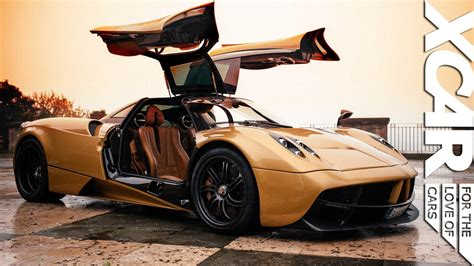 pagani huayra gold up and personal with a gold pagani huayra