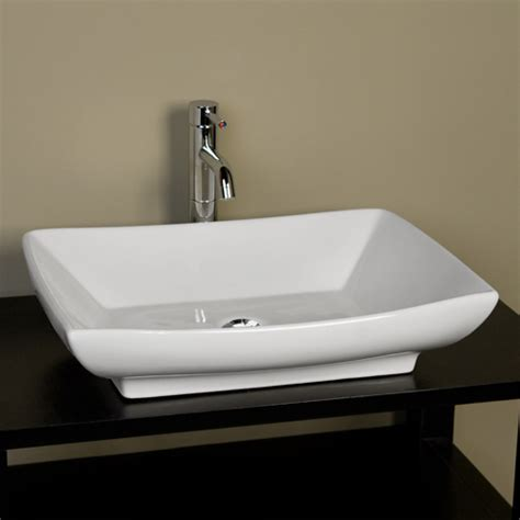 homebathroomrectangular travertine vessel sink with slope