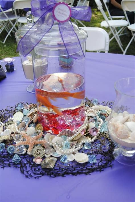 live centerpieces table netting shells and treasure table decor mermsid