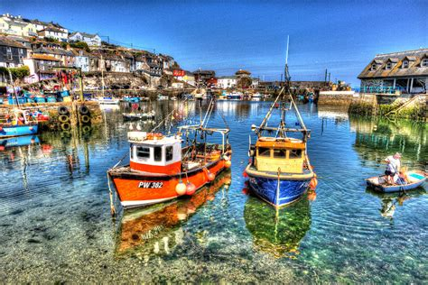 boats england boats in mevagissey harbour cornwall england blue sea and