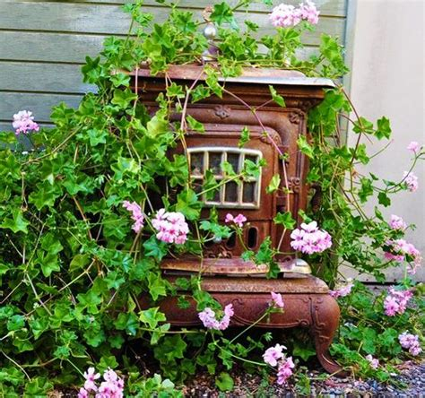 Recycling Old Stoves For Metal Planters To Save Money On Wooden Garden Decorations