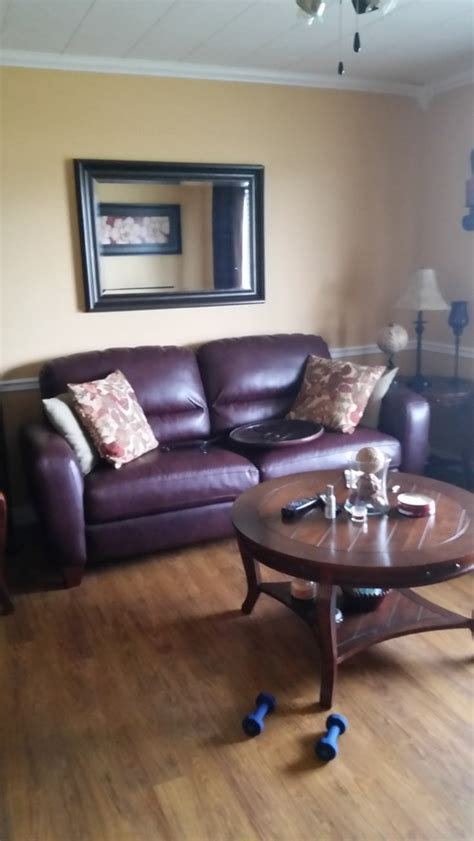 how to decorate with leather furniture help trying to decorate around a burgundy leather couch