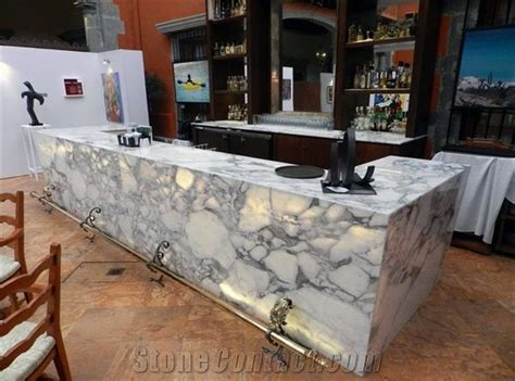 Arabescato Mossa Marble Bar Top and Ticul Dorada Limestone
