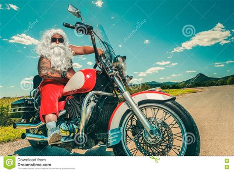 summer motorcycle riding santa on a motorcycle stock photo image 76735439