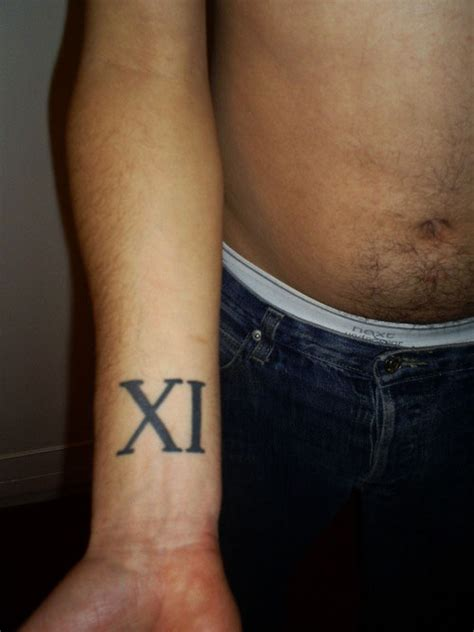 roman numerals wrist tattoo 26 ingenious numeral tattoos for 2013 creativefan