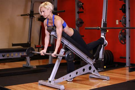 incline bench curls barbell curls lying against an incline exercise guide and