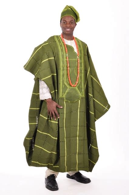 design of agbada with aso ofi clothing material aso oke is traditional symbolic nigerian clothing is a
