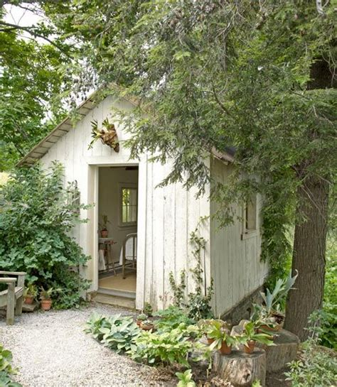 a pretty white garden retreat potting sheds
