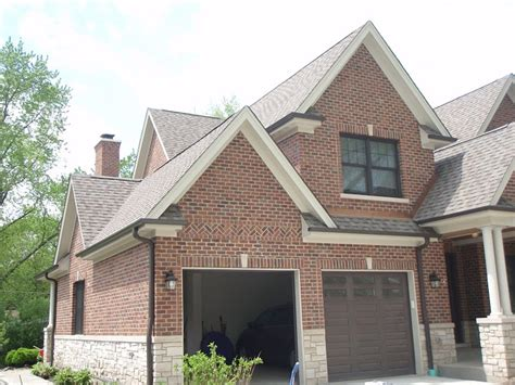 our brick with weathered wood roof bronze gutters trim paint to be