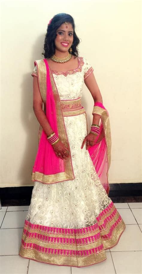 hairstyles for party on lehenga indian bride wearing bridal lehenga and jewellery