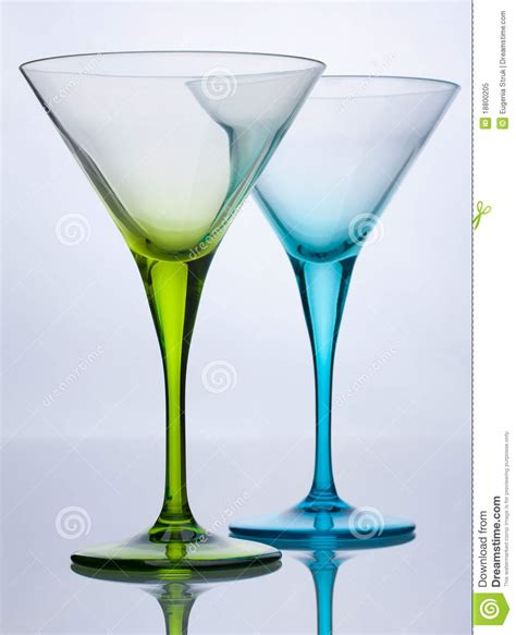 green cocktail black background green and blue empty cocktail glasses royalty free stock
