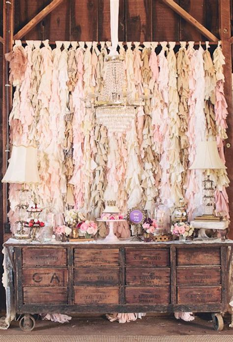 cake table backdrop fringe fabric backdrop rustic dessert table and dainty floral details weaver this