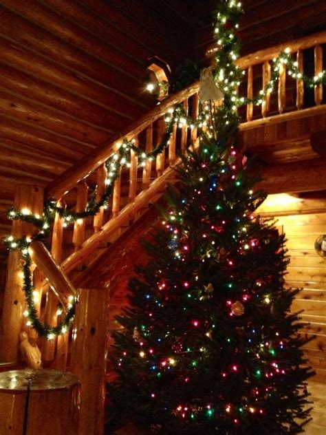 christmas decorations in homes log homes logs and christmas on pinterest