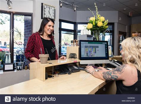 receptionist attending to customer in hair salon stock photo royalty free image 119539628 alamy
