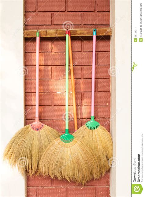 hang pictures on wall brooms hang on wall stock image image 38724711