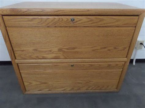 Lot Detail Oak Two Drawer Locking Lateral File Cabinet Oak Lateral File Cabinet 2 Drawer