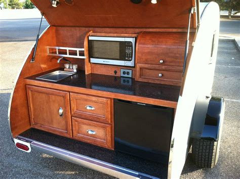 teardrop trailers hitch a tiny kitchen to your car the kitchn tiny yellow teardrop ten best teardrop galleys cers