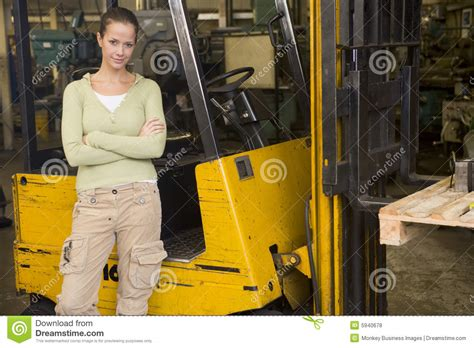 warehouse worker standing by forklift royalty free stock