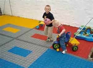 backyard play area flooring using interlocking plastic