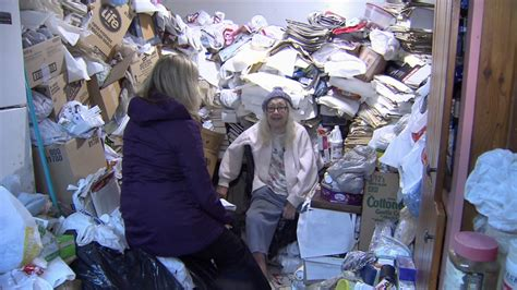 home reno company volunteers help clean up b hoarder s