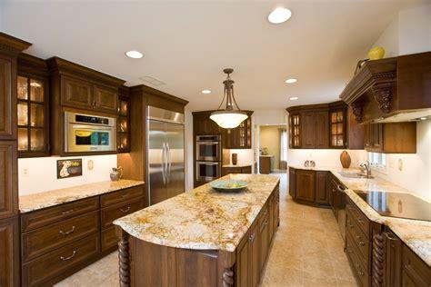 best granite color for white cabinets oak cabinets and white granite counters granite