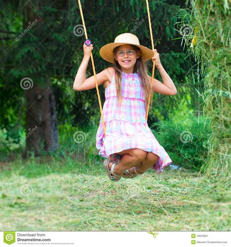 the girl in the swing young girl on swing stock image image 19879261