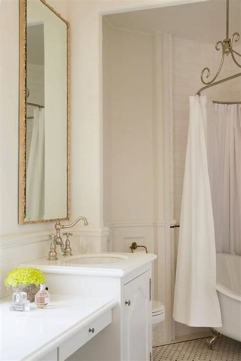 french bathroom with oval shower rail and claw foot tub