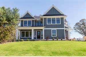 Black exterior window trim exterior farmhouse with covered entry dark gray exterior steep gables