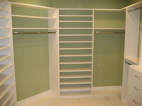 Walk In Closet Shelving Units by White Painted Pine Wood Closet Shelving Unit Mixed With Green Wall Color Of Fashionable Walk In