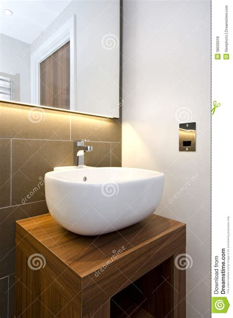 bathroom detail of a stylish designer hand wash basin with