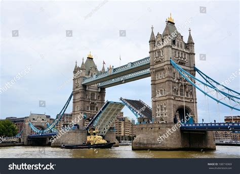 thames river cruise tower bridge tow boat on river thames passing stock photo 108716969