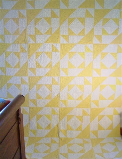 yellow pattern on white yellow white triangles unknown pattern quilt sold cindy
