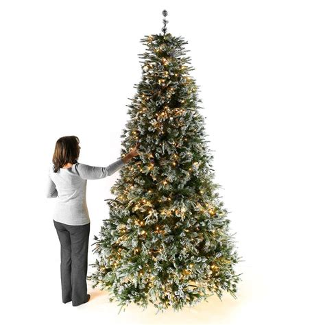 green head christmas tree snow fall 9ft pre lit green snow effect liberty pine artificial tree with pine cones