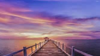 Beaitful beautiful sunrise over the white pier wallpaper walldevil
